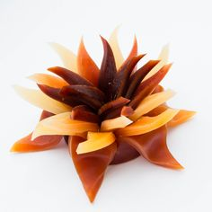The candle is in the shape of a beautiful, HAND CARVED flower ( small, medium, large ).