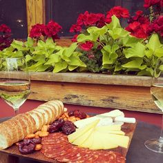 Ready to kick off the weekend? Our Red Light Special #cheeseboard #wine #patio #perfection Photo by elephantsdeli