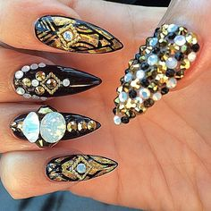 Stiletto nails with nail art and bling