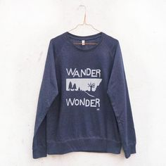 Wander: Wonder. The jumper for those who like to get out, take it slowly, and really explore the world around them. Made from a high quality blend of 60% recycled organic cotton and 40% recycled polyester from bottles, the eco-credentials of this sweatshirt ensure you're not exploiting the world you're enjoying too. Soft, thick salvage (60% organic cotton, 40% recycled polyester) raglan sweatshirt with 'WANDER: WONDER' design in light grey on front and Lost Shapes logo on back. Thick jersey…