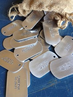 **Listing is for ONE hand-stamped custom tag with name and date. tag size = 2 in. x 1 1/8 inch. This 14 gauge (gauge is a measure of the thickness of a metal) silver aluminum dog tag can be personalized for your special military themed wedding or event. Each tag is stamped by hand one letter at a time. As such, No two tags will look exactly alike. Have another idea? just let me know and we can customize your tag. Your guests will have a special momento from your big day that they can turn…