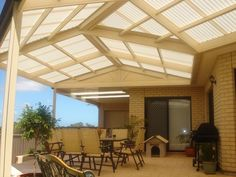 Rear patio on levels pergola seating area w firepit by