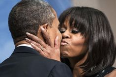 President Barack Obama is kissed by first lady Michelle Obama during an inauguration reception at the National Building Museum on Jan. 20, 2013 in Washington, DC.