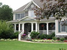same house... love the porch and landscaping except the big bush