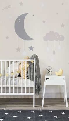 In love with the soft neutrals in this modern nursery space. Both charming and calming, this nursery mural features a crescent and cloud mobiles. The simplicity of the colour palette make it perfect for gender neutral nurseries.