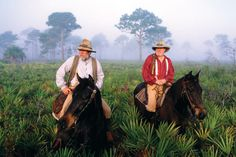 Florida's rich past comes to life thanks to living history re-enactors. Captured by photographer Carlton Ward crossing palmetto prairie at Lake Kissimmee State Park in Polk County, the men are bringing a bit of Florida's pioneer heritage back to teach new generations of Floridians about the state's frontier past.