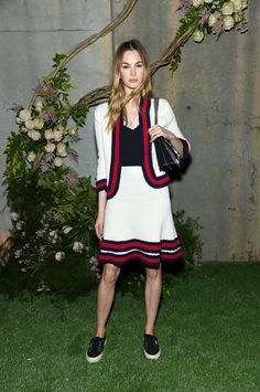 Laura Love in a Gucci Cruise 2017 Web stripe trimmed jacket and skirt.