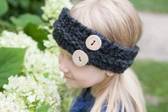 """""""Squeasie"""" Mini Top-Model Winter Headband. Stop by and pick up this free knitted head band pattern for a child. It's perfect for those cool spring or fall days. Add some rustic buttons for a unique touch."""