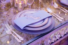 A mini glass slipper waits to be discovered by a true love at this Cinderella inspired wedding reception