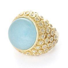 Sea foam ring.. Annie's wedding ring, possibly ?