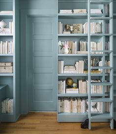 Love the idea of a secret room ... For a book-loving client bound by tight quarters, Washington, D.C.-based designer Lauren Liess doubled her storage space by adding a bank of extra-tall shelves that slides open to reveal a bathroom door.
