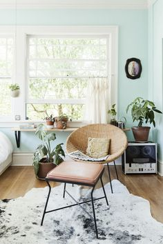 Love the wall colour, plants & chair. Would probably skip the rug.