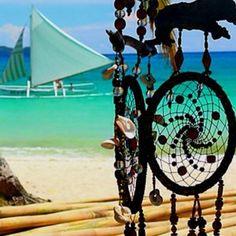 On the beach under a dream catcher - ahhhh, what a life.