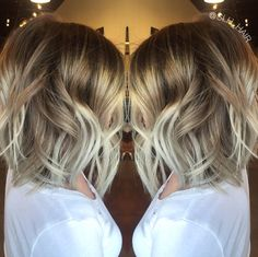 Melted dark blonde balayage with icy blonde ends. Low maintenance hair color. Beach waves. Textured Bob.