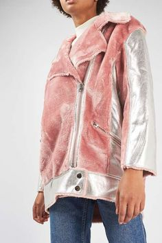 Say hello to your latest luxe outerwear staple of the season. This long-line biker jacket comes in a hybrid style with pink faux fur to the collar and bodice and a silver metallic finish to the sleeves and hem. Finished with shiny silver trims and zip up fastening, this unique style is best styled with step hem jeans for a total fashion look. #Topshop
