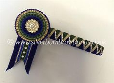Antique green velvet, navy velvet and gold lame sharkstooth show browband shown detailed with Swarovski crystals and standard swallowtail flags  www.silverburnbrowbands.co.uk