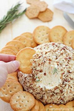 Easy Cheese Ball ~ sure to impress any guests...creamy, tangy, irresistible and won't take more than a few minutes to whip up! | yummyhealthyeasy.com