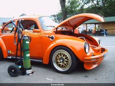 OMG!!! That's a freaking brilliant idea. Nice VW Super Beetle (1303 german look) that has air jacks built into the car frame with custom air jack input on front of car. Just attach hose, cars lifts up... no sweat! Literally... :) I'll be stealing this idea.