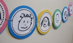 Classroom DIY: DIY Circle Banners: can have kids decorate own circle with picture and name and use in hall, attach a clothespin and hang student work.