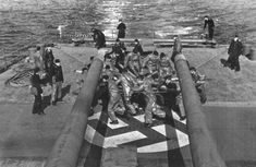 The crew of the German cruiser Prinz Eugen manually operates her rudder after suffering a torpedo hit to the stern February 1942 Prinz Eugen, Heavy Cruiser, Prince, History Page, History Online, Famous Photos, Battleship, World War Ii, Germany
