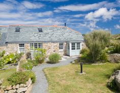 Bishops Rock is a beautiful three-bedroom self catering holiday cottage situated at Longships Watch,. Double Bedroom, Large Windows, Ground Floor, Bed Linen, Cornwall, Laundry Room, Wi Fi, Catering, Benefit