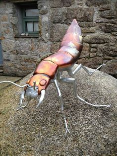 Devil's Coach Horse Beetle Commissioned by a private collector for display in their gardens. They wanted a beetle that would withstand all weather conditions. We made the beetle from mild steel and copper and finally treating the steel with hot dipped zinc galvanise. The beetle will out live us all and will be enjoyed by future generations. Made by Thrussell and Thrussell 2014