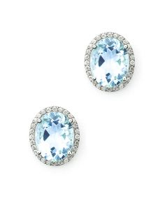 Oval Shaped Aquamarine Diamond Stud Earring - 18K White Gold --- MBLife.com New Selection on the colorful gem stone jewelry. Would this be your new accessory in your own collection. Total Diamond Weight: 0.23 ct. (56 round diamonds in total). Two Ovary Shaped Aquamarine *** Free Global Shipping *** US$880