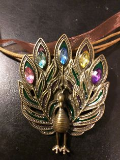 Victorian Gold Peacock on 3 Leather Cords and Organza Ribbon by KudzuCatCreations on Etsy
