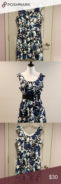 """Donna Ricco Fit and Flare Dress Darling fit and flare style dress by Donna Ricco in a fun geometric print. Semi-textured cotton fabric in shades of aqua, blue, black and white. Add a belt for even more waist definition (belt not included.) Looks great with a cardigan or jacket for shoulder coverage. Fully lined. Bra friendly (has bra keeps). And has pockets!!!  Worn once - excellent pre-owned condition  100% cotton. 100% polyester lining. Machine wash  Approx. 38"""" length, 20.5"""" across bust…"""