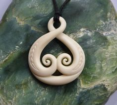 Eternal Love symbol in bone , Hand carved with engraving~ Maori symbol by JackieTump on Etsy
