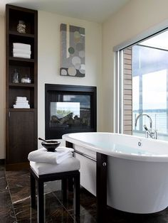What makes relaxing in the tub even better? A warming fireplace! More bathroom upgrades: http://www.bhg.com/bathroom/remodeling/planning/our-favorite-bathroom-upgrades/?socsrc=bhgpin100313fireplace&page=8