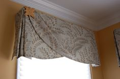 Simple, elegant valance with a beautiful metal detail, over a window shading