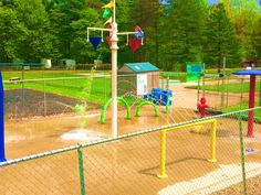 This YMCA campground splash pad that we installed a few years ago. They add to their water park every year by purchasing new features. This year they added the whimsical 4 piece Snake and the Square Hoop. They have one more feature base to fill and then maybe they will do a safety surface next year. Backyard Dog Area, Dog Friendly Backyard, Backyard Patio, Backyard Landscaping, Backyard Ideas, Preschool Playground, Water Playground, Playground Ideas, Backyard Splash Pad
