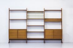 """Three  sections bookshelf  in teak produced by String AB in Sweden. Model """"Parad"""" available at tack-market"""