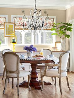 A Bit of Glamour - LOVE this round pedestal table and chairs! Also love the fabric print window shades..
