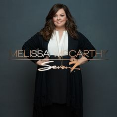 Melissa McCarthy is a apple body shape. What a great outfit on her. The dress is lighter by her bust and darker over her stomach which is an excellent disguising trick. And over the top she's wearing a long line cardigan that makes her look longer and leaner. Top marks!