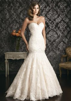 A gorgeous mermaid shaped gown. The fitted bodice has a sweetheart neckline and dropped waist. The entire design is adorned with delicate lace applique.