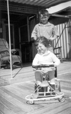 Bobby, age 8, plays with his two-year old brother Teddy Kennedy, 1934.