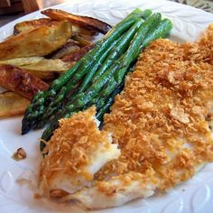 Cornflake fish - 2 tbsps  mayonnaise  1/2 tsp  italian seasoning  1/4 tsp  salt  1/4 tsp  pepper  1 lb  orange roughy fillet  1/2 cup  crumbs (fine corn flake).  Bake 400 for 12 min.