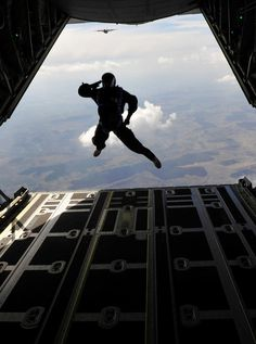 """US Air Force Pararescueman (Pararescue Jumper) a.k.a. """"PJ"""" jumping out of the back of an aircraft with a departing salute.  These are the guys who rescue downed pilots, NASA astronauts, other fallen soldiers in the battlefield AND rescue the US Navy's SEALS when needed! These are the most bad-ass mutha's on the planet!"""