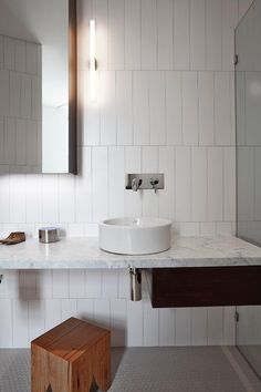 Luxury Modern Bathroom With White Marble Vanity And White Round Sink Also Traditional Wooden Bench And Wooden Cabinets Design Ideas: Butter Factory Transformed into Sculptural Modern Loft Apartment Modern Bathroom Tile, White Bathroom, Bathroom Interior, Small Bathroom, Minimalist Bathroom, Bathroom Layout, Modern Bathrooms, Bathroom Ideas, Design Bathroom