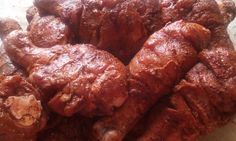 8 pcs of chicken thighs (skin out) marinate in 1/4 cup natco or rajah tandoori masala, 1/4 cup lime juice, salt to taste and keep aside for 3/4 hours. Grill 15 min each side, turn and grill. Serve with slices of onion and wedges of lime/lemon.
