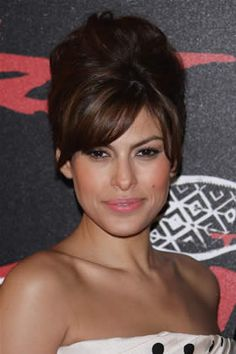 Eva Mendes is the master of Bardot redux. It's the utter messiness of this updo that gives it a casual sexiness. Backcomb hair all over at the roots with extra lift at the crown. Pull hair back and fasten into a twist. Brush the top layer minimally to style.