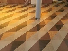 Installation photo provided to us by our client, Distinct Flooring, of a job we cut for them. Job comprised of 5 different colours of Marmoleum sheet, cut into 340mm triangles, 2160 elements in total. The job was installed at Wahaca in Brighton. Another happy client! #marmoleum #marmoleumsheet #triangles #flooring #design #designcutting #debruyns