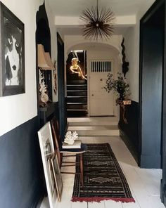 black and white walls by Painted Floorboards, Half Painted Walls, White Floorboards, Black Painted Stairs, Dark Walls, White Walls, Black And White Hallway, Hallway Paint, Hallway Walls