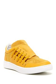 Joust EVO Sneaker in yellow; Alexander McQueen for Puma $295 - $120 @HauteLook. - Round toe - Side lace-up vamp - Suede and leather construction - Perforated and topstitched detail - Made in Italy - Leather and suede upper, manmade sole
