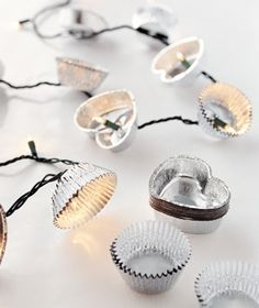 Use heart mini foil/or colorful cupcake tins with a string of white corded Christmas lights or with white corded icicle lights and use as a backdrop or a front decoration for a table skirt for a night or outdoor wedding. :) party-ideas