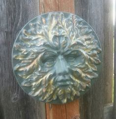 Check out this item in my Etsy shop https://www.etsy.com/listing/518452558/greenman-plaque-face-outdoor-plaque