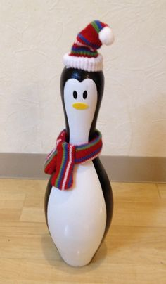 Cute bowling pin penguin. Could change out his hat and scarf for different seasonal wear.