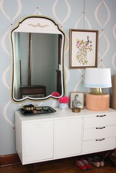 like how this is arranged - mirror, dresser, lamp, frame, etc.